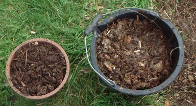 Compost suitable for a mulch, finer in the left tub